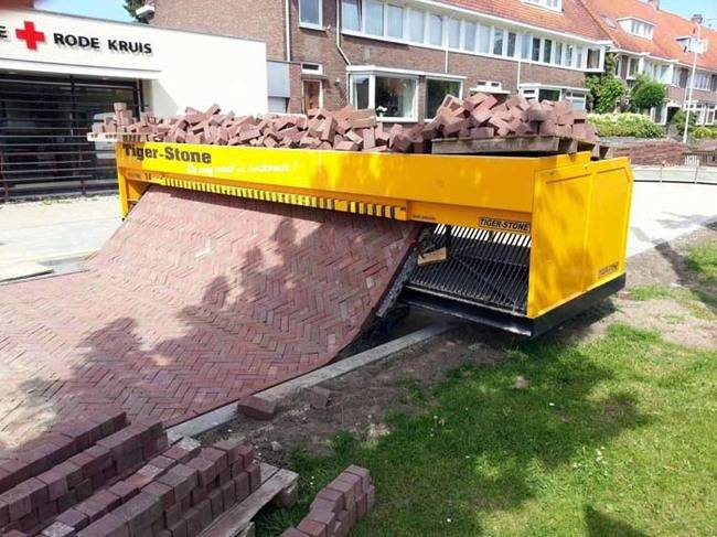 This machine weaves bricks together and then lays out paths.