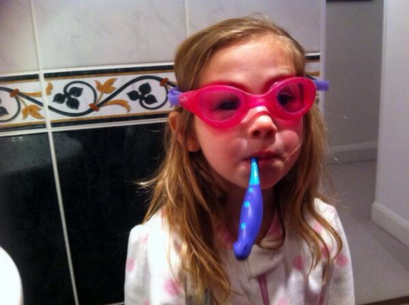 clean swimming goggles with toothpaste